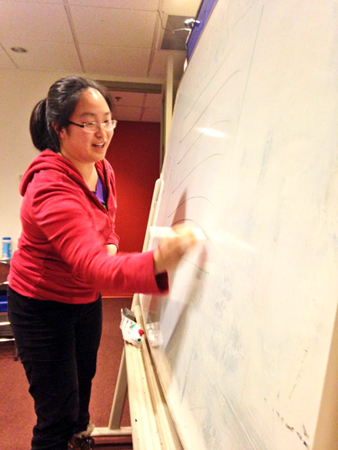 Jennifer drawing out her idea for Hexplosions at Pixelles